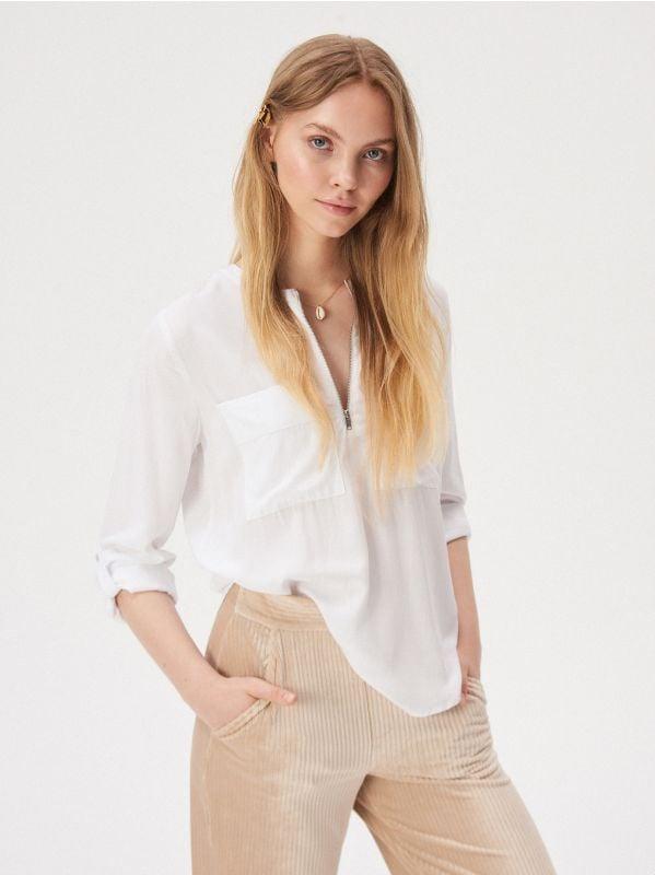 d14b11341a2cd6 Bluzka z rozkloszowanymi rękawami · Bluzka z kieszeniami - biały -  WD146-00X - SINSAY